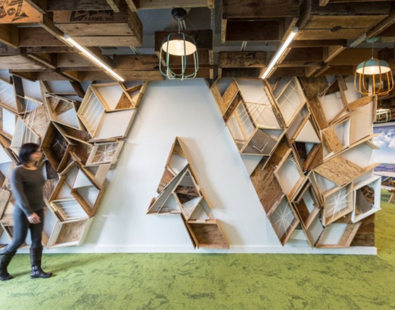 adobe office headquarters with geometric bookshelf in the shape of their logo
