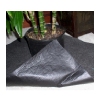 Image of drip catching mat with plant in a planter on top
