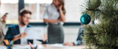 office employees enjoying holiday decorations