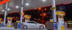 a brightly lit gas station at night for fuel consumption blog header