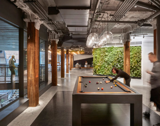 image of united technologies digital offices with a plant wall and pool table
