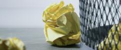 crumpled paper in a wastebasket